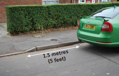 image of a car parked 1.5 meters away from the dropped kerb