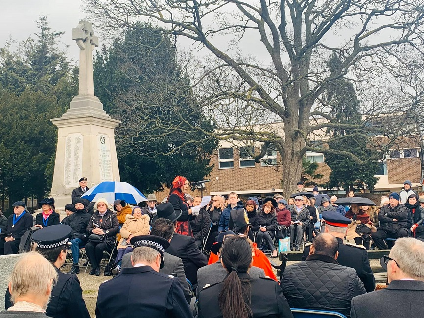 Attendees brave the weather for the Holocaust Memorial Day service.
