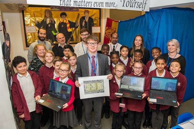 A picture of Cllr White with school children at Minecraft event