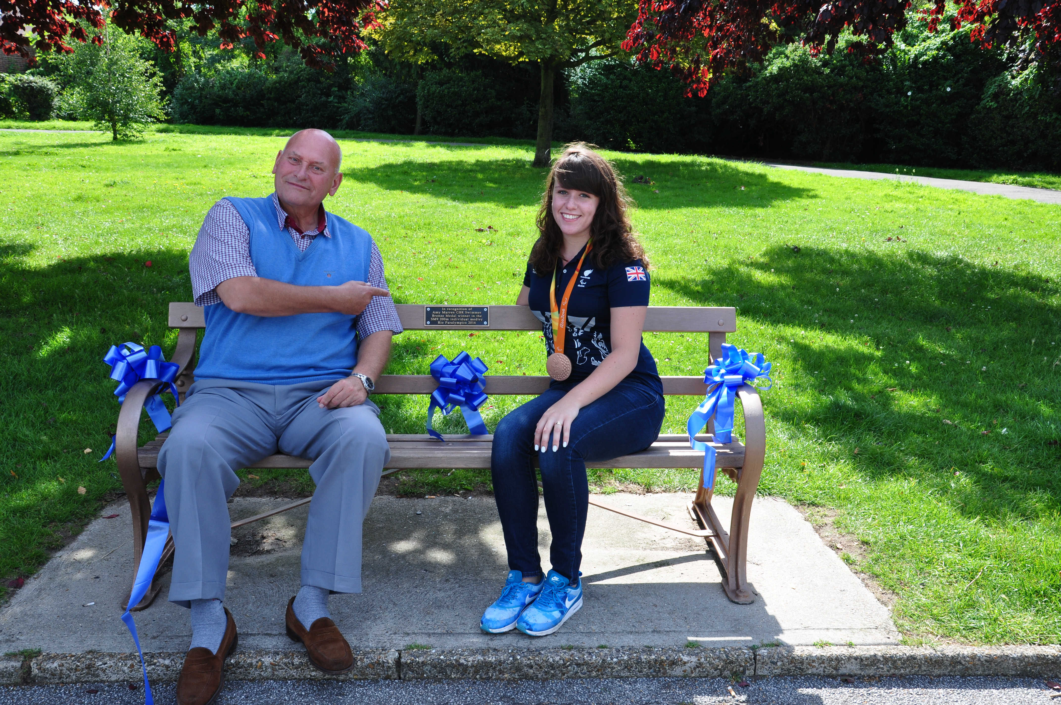Cllr Melvin Wallace sits with Amy Marren on her new bench