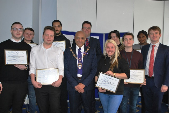 Councillor Dilip Patel, Mayor of Havering, with graduates of the Council apprenticeship scheme.
