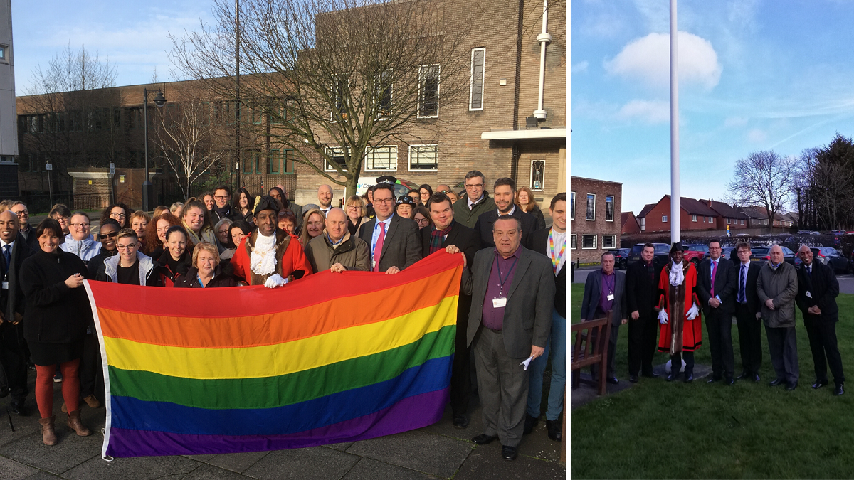 Councillors, staff and members of the public hold the Rainbow Flag