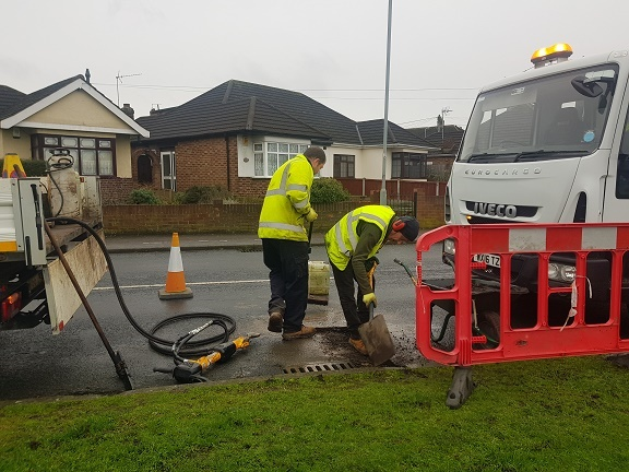 potholes being fixed by highways team